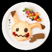 Mimikyu Crepe alla banana e cioccolato (Pokémon Café Tokyo DX).png